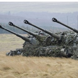 Lined up in the fire position, a battery of AS-90 used during Exercise Steel Sabre.