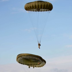 Paratroopers with C Company, 3rd Battalion The Parachute Regiment (3PARA) glide gently to Earth at the dropzone for Exercise Wessex Storm on Salisbury Plain.