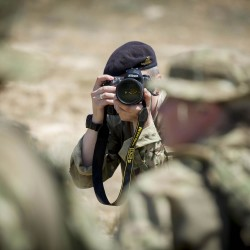 An Army Reserve photographer of the Media Operations Group (MOG)taking pictures of fellow reservists during a Media Challenge exercise in Cyprus.