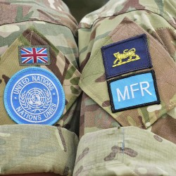 Soldiers with the Royal Engineers and deployed with United Nations in Cyprus showing their United Nations and Mobile Force Reserve (MFR) badges.