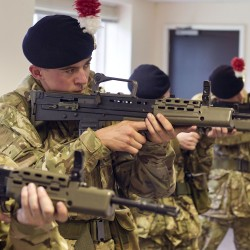 Army Reserve recruits of Somme Platoon, Basic Company, Army Training Unit (West Midlands) learn to handle the SA80 A2 Rifle safely.